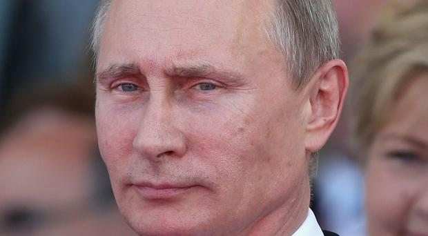 Russian president Vladimir Putin, pictured, has been accused of 'reckless and destabilising actions' by top Senate Democrat Chuck Schumer