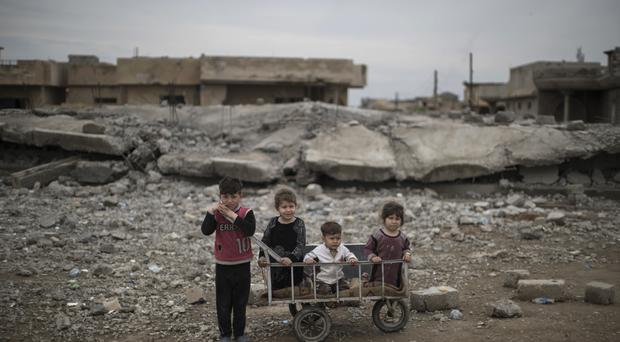 Children in a neighbourhood recently retaken by Iraqi security forces during fighting against Islamic State militants on the western side of Mosul, Iraq (AP Photo/Felipe Dana, File)