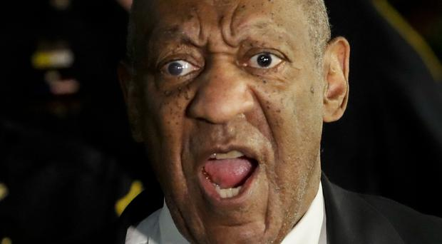 Bill Cosby yells 'Hey, hey, hey' to supporters as he leaves court during his sexual assault trial (AP)