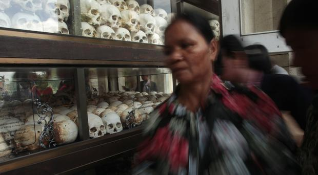 Cambodian visitors see skulls and bones of victims of the Khmer Rouge on display near Phnom Penh as prosecutors sum up in the trial of the two surviving leaders of the regime (AP/Heng Sinith)