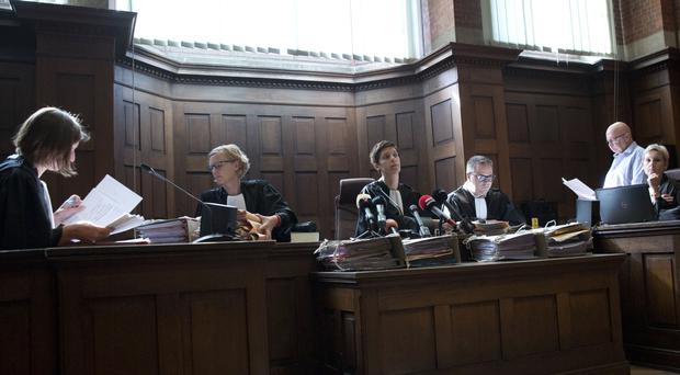 Judge Mieke Butstraen, centre, reads out the ruling in the case of baby Lucas at the Court of First Instance in Dendermonde, Belgium (Virginia Mayo/AP)