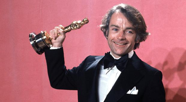 John Avildsen shows off his best director Oscar for Rocky (AP)