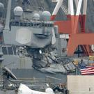 The damaged USS Fitzgerald at Yokosuka Naval Base, south of Tokyo (Kyodo News/AP)