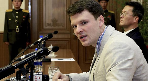 Otto Warmbier speaking to reporters in Pyongyang in February last year (AP)