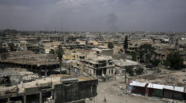 Buildings destroyed during fighting between Iraqi forces and Islamic State in western Mosul, Iraq (AP Photo/Bram Janssen, File)