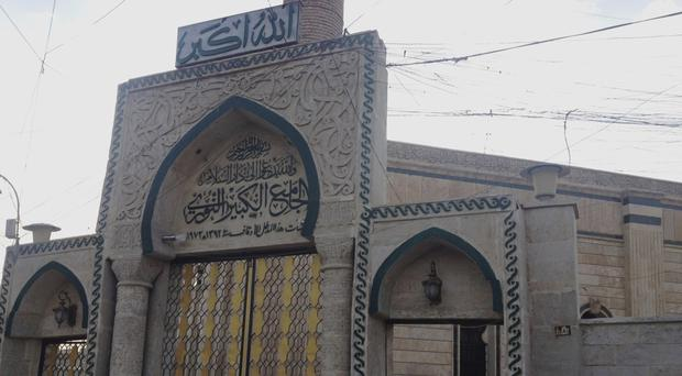 Old picture of the gate to the al-Nuri mosque in Mosul (AP)