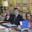President Emmanuel Macron at a cabinet meeting at the Elysee Palace in Paris (Christophe Petit Tesson, Pool Photo via AP)