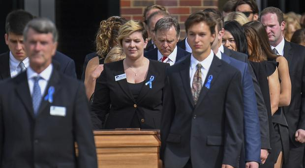 The coffin of Otto Warmbier is carried from Wyoming High School (Bryan Woolston/AP/PA)