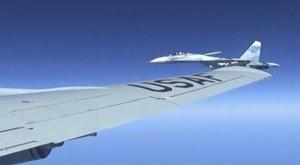 A Russian jet coming within a few feet of a US air force reconnaissance jet over the Baltic Sea (Master Sgt Charles Larkin Snr/US European Command via AP)