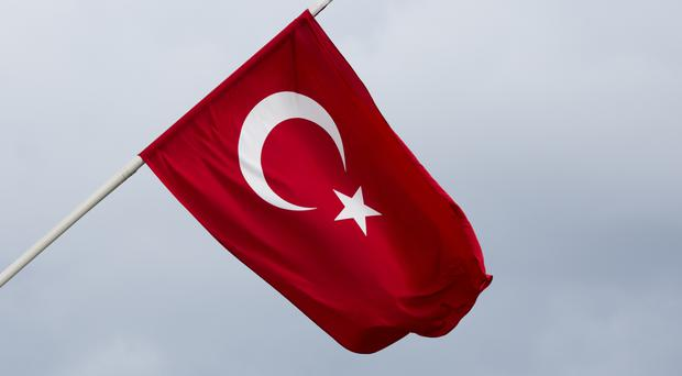 File photo dated 16/07/16 of a Turkish flag at the Turkish Embassy in central London. MPs have expressed concern about human rights and democracy in Turkey.