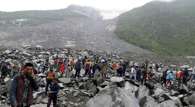Day Two in the Search for Victims Buried in China Landslide