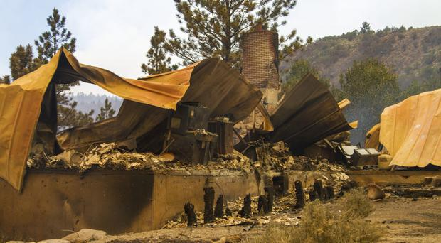 A cabin burnt to the ground by a wildfire on the west side of Panguitch Lake, Utah (Spectrum)
