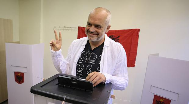 Albanian Prime Minister and Socialist party leader Edi Rama casts his ballot at a polling station in Tirana (AP Photo/Hektor Pustina)