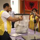 Election staff count ballots in Tirana, Albania (AP Photo/Hektor Pustina)