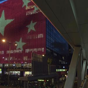 China's national flag is displayed outside a shopping centre in Hong Kong to mark the 20th anniversary of the colony's handover to Beijing (AP)