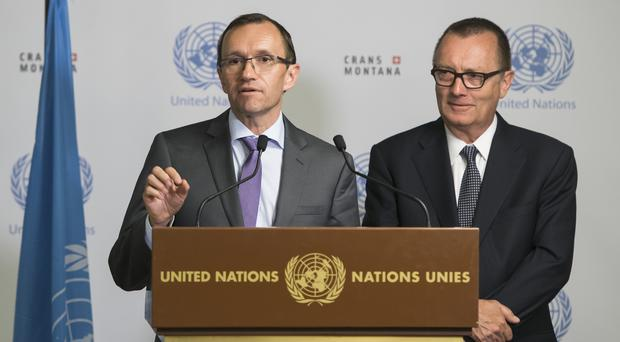 UN envoy Espen Barth Eide, left, speaks next to UN Under-Secretary-General for Political Affairs Jeffrey Feltman in Crans-Montana (Jean-Christophe Bott/Keystone via AP)