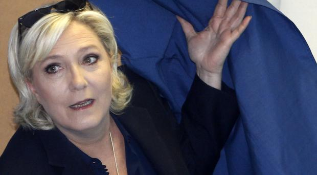 France's Marine Le Pen charged over funding scandal