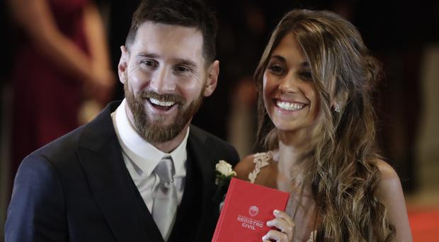Lionel Messi and Antonella Roccuzzo after tying the knot in Rosario (AP)