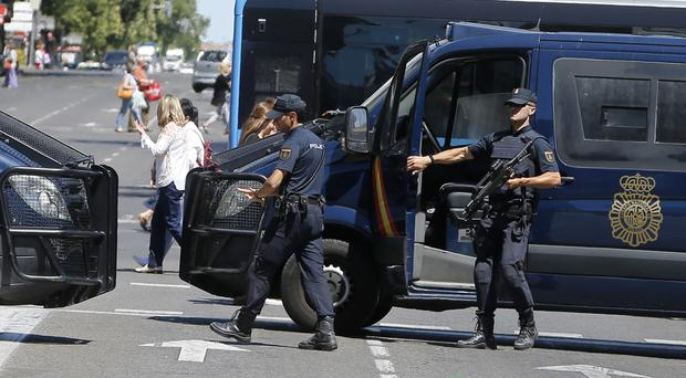 Armed police block a street for security reasons before the Gay Pride demonstration and parade (AP Photo/Paul White)