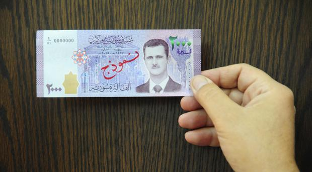 Assad's Photo Appears On New Syrian Banknote