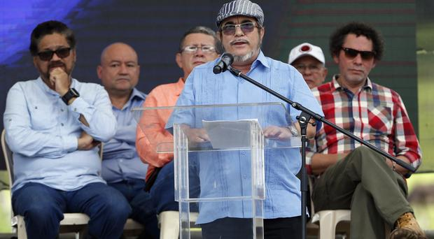 Rodrigo Londono gives a speech during an act to commemorate the completion of the disarmament process of FARC rebels (AP)