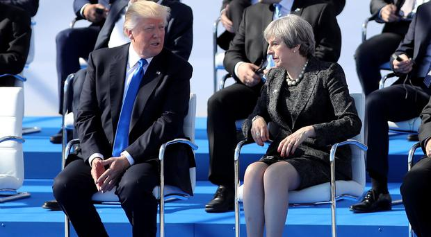 Donald Trump, pictured with Prime Minister Theresa May at the Nato summit in Brussels, posted the Wrestlemania clip on Sunday