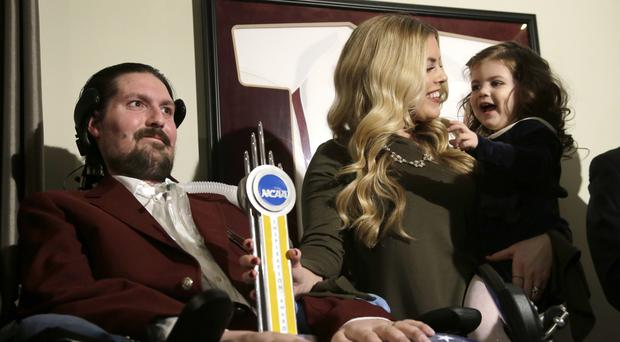 Pete Frates, pictured with his wife and daughter in December 2016 (AP)