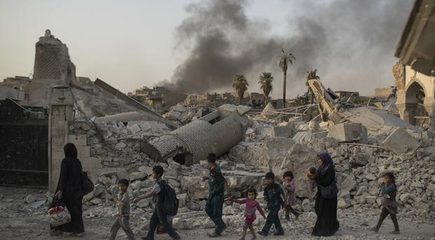 Civilians flee the Old City of Mosul as Iraqi forces continue to advance on the last area held by IS (AP Photo/Felipe Dana)