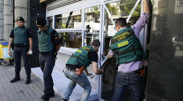 Police seal off a restaurant during an operation in Barcelon (AP)