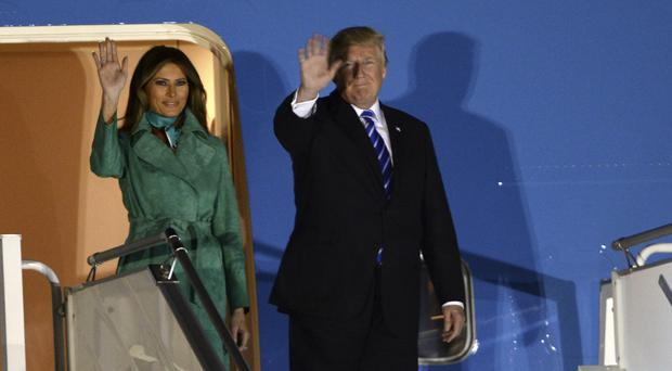 President Donald Trump and the first lady Melania wave from the Air Force One after arriving in Warsaw (AP Photo/Alik Keplicz)