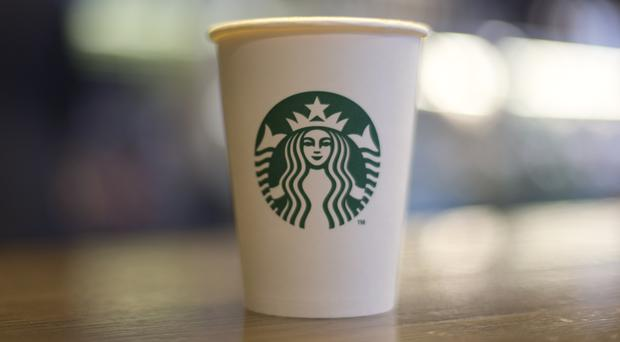 File photo dated 18/03/16 of a Starbucks coffee cup, as the US firm has blamed Brexit and a slowing economy for a dive in UK profits, while pointing to weakening consumer confidence as sales sagged.