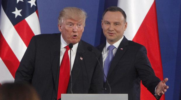 Donald Trump and Andrzej Duda at the end of a joint press conference in Warsaw (AP)