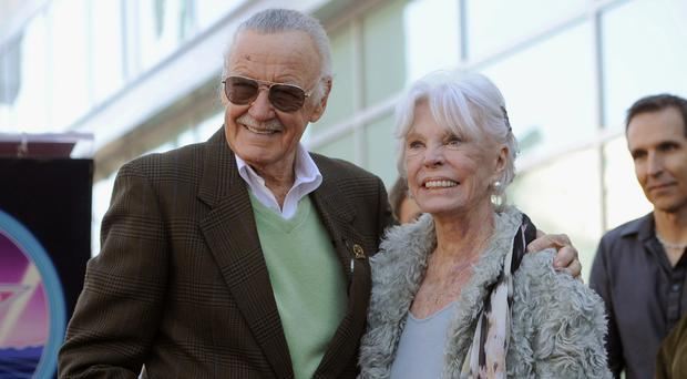 Stan Lee and his wife Joan pictured in 2011 when he received a star on the Hollywood Walk of Fame in Los Angeles (AP Photo/Chris Pizzello, File)