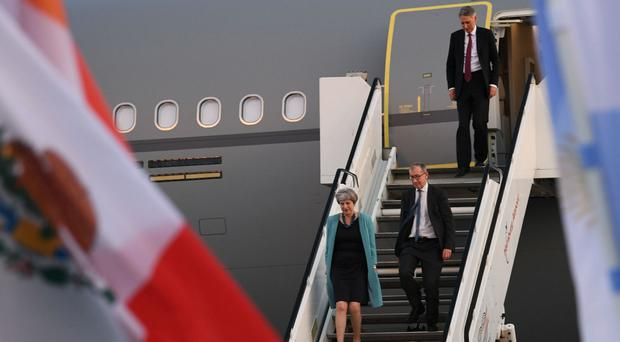 Prime Minister Theresa May and husband Philip followed by Chancellor Philip Hammond arrive in Hamburg for the G20 leaders' summit