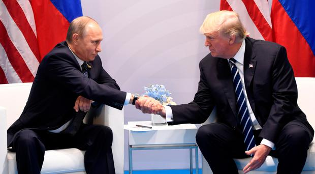 Donald Trump and Vladimir Putin shake hands during a meeting on the sidelines of the G20 summit