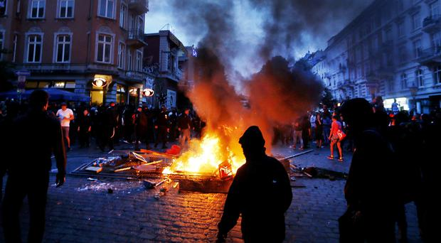 Fires were started during protestsagainst the G20 summit in Hamburg (AP Photo/Michael Probst)