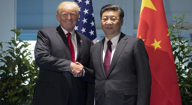 US president Donald Trump and Chinese president Xi Jinping in Hamburg (AP)