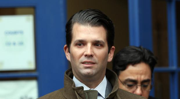 Donald Trump Jr does not serve in the administration and is not required to disclose his foreign contacts