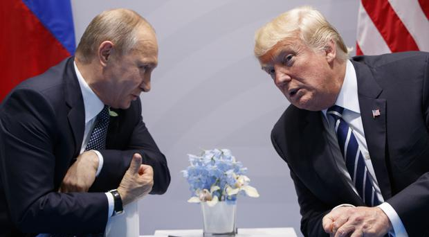 President Donald Trump meets Vladimir Putin at the G20 Summit in Hamburg (AP Photo/Evan Vucci, File)