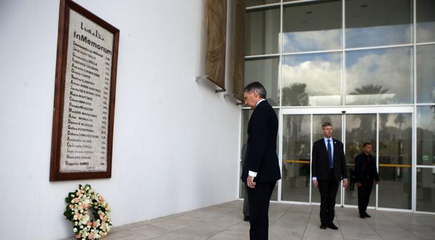 Philip Hammond lays a wreath outside the Bardo National Museum in Tunis in 2015