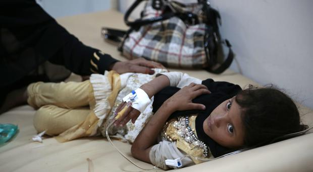 A girl is treated for a suspected cholera infection at a hospital in Sanaa, Yemen (AP)