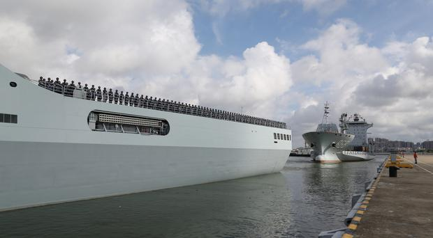 Ships carrying Chinese military personnel departs a port in Zhanjiang (Wu Dengfeng/Xinhua News Agency/AP)