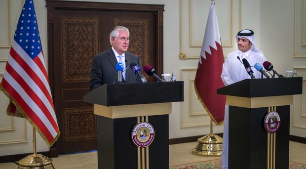 Rex Tillerson and the Qatari Minister of Foreign Affairs Sheikh Mohammed bin Abdulrahman Al Thani hold a press conference in Doha, Qatar (Alexander W Riedel/US State Department via AP)