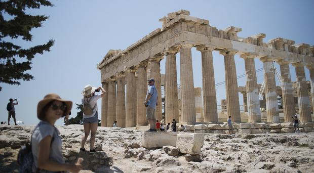 It is time that Greeks who sacrificed so much see investments from abroad, Pierre Moscovici said (AP)