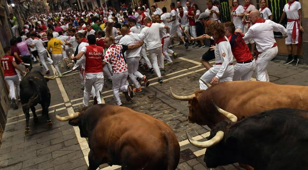 The running of the bulls at the San Fermin Festival in Pamplona (AP)