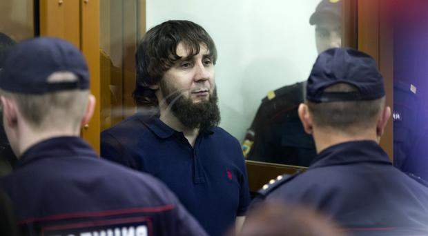 Zaur Dadayev listens to the sentence in a court room in Moscow, Russia (AP)