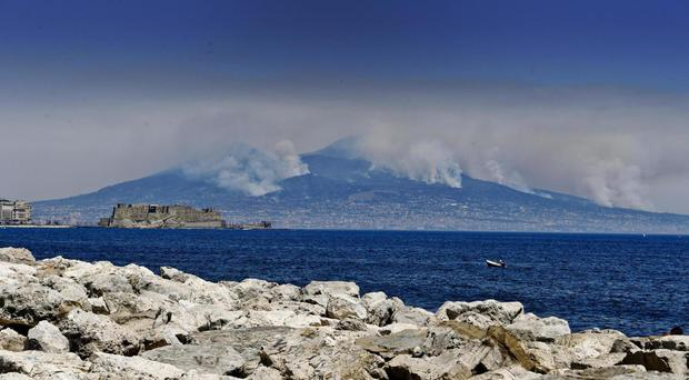 Smoke rises from wildfires burning on the slopes of Mount Vesuvius in Naples, Italy (Ciro Fusco/ANSA via AP)