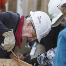Former President Jimmy Carter helps build homes for Habitat for Humanity. (AP)
