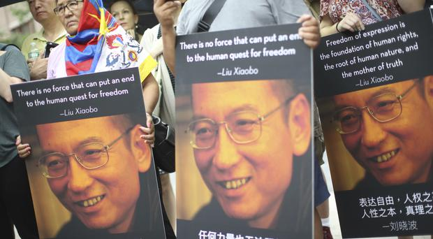China's most prominent political prisoner died of liver cancer at 61 (AP)