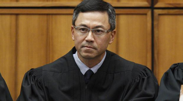 US district judge Derrick Watson expanded the list of family relationships needed by people seeking new visas (George Lee /The Star-Advertiser/AP)